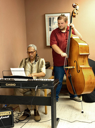 During the Ribbon cutting for Elizabeth Thompson Nelson,MD Live Music by Bob Redd on the Keyboard and Lars Swanson on the Bass.<br /> Tina Laney/for The Register-Herald