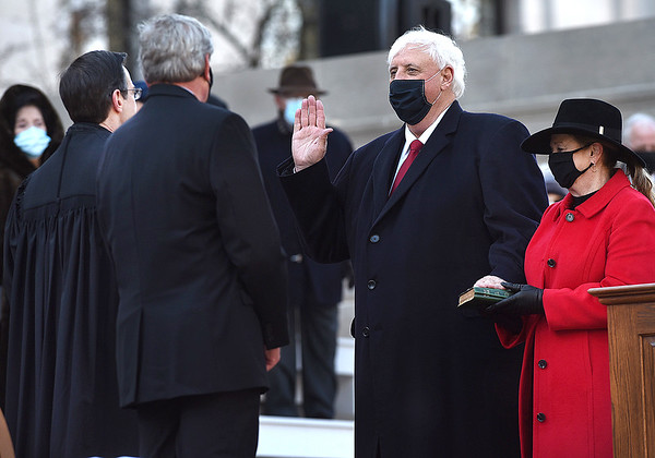 Governor Jim Justice takes the oath of office from Chief Justice Evan Jenkins for his second term as the 36th Governor of the State of West Virginia as his wife Cathy holds the Bible at the Capitol in Charleston on Friday. (Craig Cunningham/The Register-Herald)