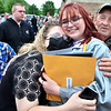 Westside graduate Jessica Kennedy hugs her family following her graduation ceremony Saturday.