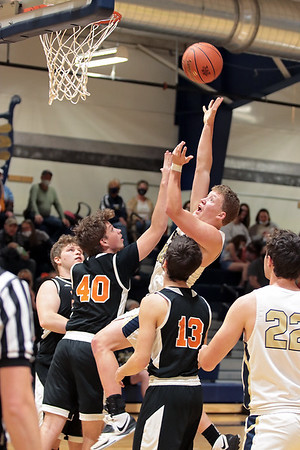 Greenbrier West's Chase McClung tries to get the ball past Richwood players during Tuesday's Class A Region 3, Section 1 tournament game at Greenbrier West High School in Charmco. Jenny Harnish for the Register-Herald
