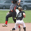 Lady Warrior Lilly Hill tags a runner out on third before throwing to second for the double play.<br /> Jim Cook/ for the Register-Herald