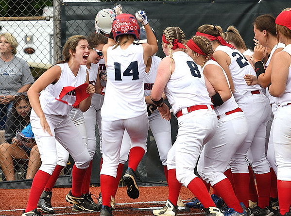 Sydney Sheets,  14, of Midland Trail, get greeted by her teammates after hitting a first inning homerun against Ritchie County during the Class A State Softball Tournament held at Little Creek Park in South Charleston.<br /> (Rick Barbero/The Register-Herald)