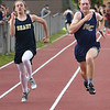 Jacob Lilly, of Shady, Left, runs neck and neck with Levi Miner, of Nicholas County in the 100 meter dash during the H.B. Thomas Invitational at Shady Spring High School Tuesday evening.<br /> (Rick Barbero/The Register-Herald)