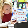 Haley Lane, special education teacher, Jumping Branch Elementary School, doing double digit multiplications lession with 5th grader Noel Bragg remotely.<br /> (Rick Barbero/The Register-Herald)