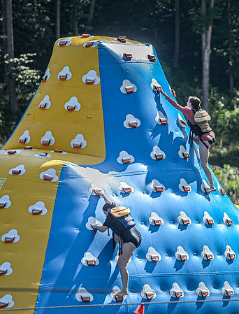 Girl Scouts from around the country test their skills at Ace Adventure Resort on Monday in Oak Hill. F. Brian Ferguson/Register-Herald