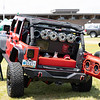 Eric Hatcher showing off his 2015 Jeep Wrangler during the Friends of Charity Auto Fair.<br /> Tina Laney/for The Register-Herald