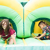 Children play in the inflatable bouncing houses at the Day of Hope event at the Beckley Convention Center. Chad Foreman for the Register-Herald.