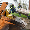 "Josh Buchanan, left, David ""Rockstar"" Cook, and Russel Potter, Beckley Board of Public Works employees, load up material in Ward 1 on Westwood Drive during the City's annual  Spring Clean-up, a popular free service that the City of Beckley offers annually to citizens. Work crews with two loaders and twenty trucks working in Ward 1 and 2 were experiencing larger than nomal loads this year because it was suspended in April 2020 due to COVID-19 concerns. The Public Works Department started collecting spring cleanup items on Monday, April 19 and will continue for the next couple weeks until they reach every street in thier five wards.<br /> <br /> All items in all wards are to be placed within 5 feet of the curb and no return visits will be made to any streets after it has been completed. The City will not pick up, tires, hazardous waste, petroleum products. (oil, gasoline, etc.) Yard Waste. (tree limbs, logs, brush) Demolition materials, batteries, liquids. (paint thinners, pesticides, or insecticides) No white goods. (washers, dryers, or refrigerators, freezers, air conditioners, or stoves)<br /> (Rick Barbero/The Register-Herald)"
