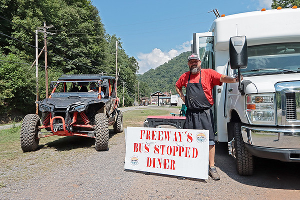 """Local entrepreneur Jeff Meadows stands next to his newly opened roadside diner """"Freeway's Bus Stopped Diner"""" for ATV riders in Mullens Wednesday. Jenny Harnish/The Register-Herald"""