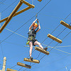 Girl Scout Bailey Philyan of Hurricane, WV tests her balance in the Adventure Park at Ace Resort on Monday in Oak Hill. F. Brian Ferguson/Register-Herald