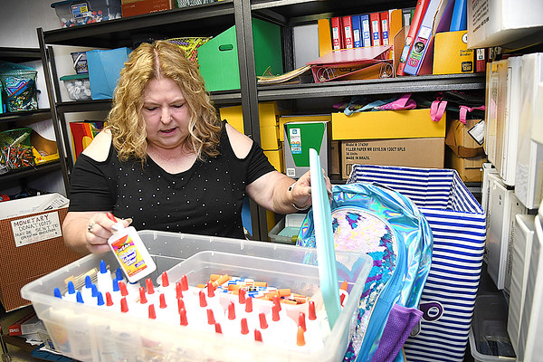 Cindy Parker getting school supplies ready for Operation Backpack at Mabscott United Methodist Church.<br /> (Rick Barbero/The Register-Herald)