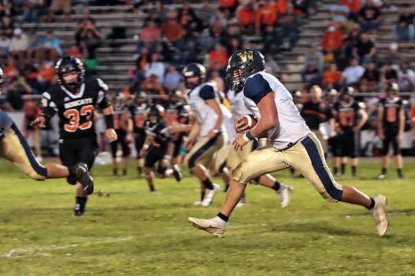 Greenbrier West's Ty Nickell runs for a touchdown during the game against Summers County at Summers County High School in Hinton Friday. Jenny Harnish/The Register-Herald