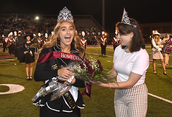 Woodrow Wilson 2020 Homecoming queen Caroline Booth, right, crowns Mallory Daniel queen at halftime during the Woodrow Wilson vs Princeton game Friday night at VanMeter Stadium in Beckley.<br /> (Rick Barbero/The Register-Herald)