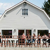 Customers of the Frozen Barn enjoy a warm day and ice cream along East Main Street in Oak Hill. F. Brian Ferguson