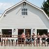 Customers of the Frozen Barn enjoy a warm day and ice cream along East Main Street in Oak Hill. F. Brian Ferguson