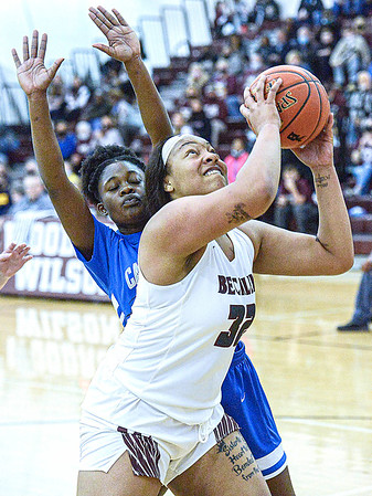 F. Brian Ferguson/ Register-Herald Capital's Natayla Bayles, left, defends as Woodrow Wilson's Jamara Walton drives for the score during Wednesday evening action in Beckley.
