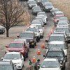 Vehicles line up during  a drive-thru COVID-19 vaccine clinic held Friday, January 8 from 9:00am-3:00pm at the Beckley Raleigh County Convention Center. This clinic provided 650 vaccines for 80 and over population of Raleigh County.<br /> (Rick Barbero/The Register-Herald)