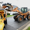 Beckley Board of Public Works employees, load up material in Ward 1 on Westwood Drive during the City's annual  Spring Clean-up, a popular free service that the City of Beckley offers annually to citizens. Work crews with two loaders and twenty trucks working in Ward 1 and 2 were experiencing larger than nomal loads this year because it was suspended in April 2020 due to COVID-19 concerns. The Public Works Department started collecting spring cleanup items on Monday, April 19 and will continue for the next couple weeks until they reach every street in thier five wards.<br /> <br /> All items in all wards are to be placed within 5 feet of the curb and no return visits will be made to any streets after it has been completed. The City will not pick up, tires, hazardous waste, petroleum products. (oil, gasoline, etc.) Yard Waste. (tree limbs, logs, brush) Demolition materials, batteries, liquids. (paint thinners, pesticides, or insecticides) No white goods. (washers, dryers, or refrigerators, freezers, air conditioners, or stoves)<br /> (Rick Barbero/The Register-Herald)
