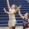 Shady Spring's Kierra Richmond drives for the score as Independenc'e Emily Suddreth defends during Wednesday evening action in Shady Spring. F. Brian Ferguson