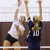(Brad Davis/For The Register-Herald) Woodrow Wilson's Elysia Salon attacks as Shady Spring's Braylie Wiseman tries to block during Shirley Brown Invitational action Saturday morning in Beckley.