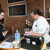 Kaitlyn Sizemore, of Beckley, left, places an order with Tabbitha Mains, owner, left, at Coffee On Main on Main Street in Beckley.<br /> (Rick Barbero/The Register-Herald)