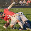F. Brian Ferguson/Register-Herald Oak Hill's Braxton Hall injures his ankle early in the game as Nicholas County's Kaleb Clark makes the stop during Friday evening action in Oak Hill. Oak Hill's Hall was put out of the game,