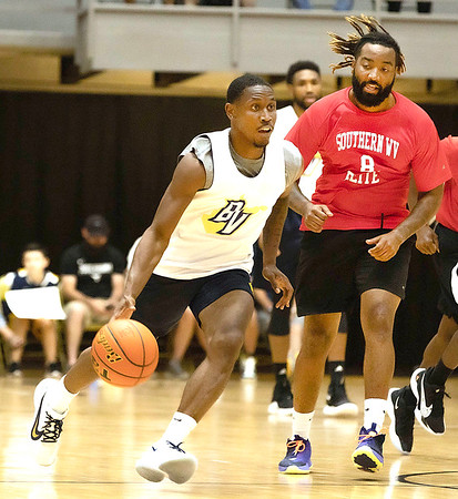 Juwan Staten with Best Virginia drives past Dexter Moore of Southern WV Elite.<br /> Tina Laney/for The Register-Herald