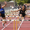 Clayton Lee, of Princeton, left, and Jahzara Nelson running in the 110 meter high hurdles during the H.B. Thomas Invitational at Shady Spring High School Tuesday evening.<br /> (Rick Barbero/The Register-Herald)
