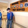Bob McGraw, volunteer, left, escorts Ureal Allen, of Fairdale down the hallway at Beckley VA Medical Center.<br /> (Rick Barbero/The Register-Herald)