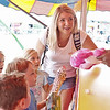 Friends Dolly Knight, 5, Kellen Henderson, 5, Alexander Simcox, 4, and Maddie Dillon, 5, all win prizes at Fat Alberts at the State Fair of West Virginia in Fairlea Wednesday.  Jenny Harnish/The Register-Herald