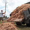 SJ Goodwin puts mulch down for fair cows to lay on at the State Fair of West Virginia Tuesday in Fairlea. Jenny Harnish/The Register-Herald.