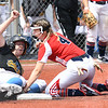 Sydney Brown, of Oak Glen, left, slide save under tag put on by, Alli Hypes, of Independence, during the Class AA Girls State Softball Tournament held at Little Creek Park in South Charleston.<br /> (Rick Barbero/The Register-Herald)