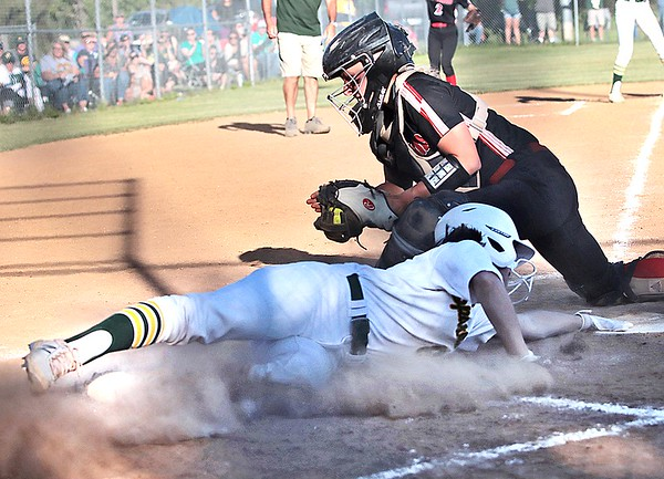 Greenbrier East's Annabelle Honaker makes it safely to home during the Class AAA Region 3 championship game against Greenbrier East in Fairlea Wednesday.  Jenny Harnish for the Register-Herald
