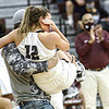 F. Brian Ferguson/Register-Herald Woodrow Wilson's Cloey Frantz is carried off the court after being injured in the third quarter during Wednesday evening action in Beckley.