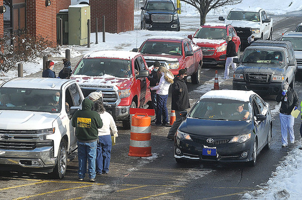 Cars line up at the Raleigh Regional Covid -19 Vaccine clinic at the Raleigh County Convention Center. Jon C. Hancock/for The Register-Herald