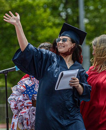 F. Brian Ferguson/Register-Herald  Independence graduate Jayla Lester gives a wave after receiving her diploma on Saturday in Coal City.