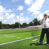 Raleigh County Schools Superintendent, David Price looks over the new turf getting laid down at Shady Spring High School football field. Price said the field would be ready for Friday's home opener against Tug Valley and crews from The Motz Groupare are laying the turf and PCM Contractor from Sophia are working on the bleachers. Price said, they are are adding wheel chair ramps and seating for the handicap and also placing new handrails in each section of the bleachers. The visitor bleacher will not be completed by kickoff Friday, but will have designated seating for the opposing team.<br /> (Rick Barbero/The Register-Herald)