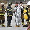 Tom Cochran, airport manager, third from left, speaks with Fire fighters after a training putting a fire out of a simulator airplane held at the Raleigh County Memorial Airport in Beaver Wednesday morning. <br /> (Rick Barbero/The Register-Herald)