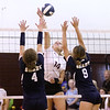 (Brad Davis/For The Register-Herald) Woodrow Wilson's Olivia Ziolkowski attacks as Shady Spring's Rachel Mann, left, and Aly Holdren try to block during Shirley Brown Invitational action Saturday morning in Beckley.
