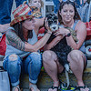 """F. Brian Ferguson/Register-Herald  Gretchen Myers, left, covers the ears of """"Luna"""" from the noise of fire engines as Brittany Kennedy, right, takes in the Fayetteville July 4th parade on Saturday afternoon."""