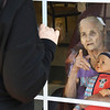 Melissa Blair communicates with her mom, Thelma james, through a window at Harper Mills Nursing Home in Beckley on March 28, 2020. Her mom was not allowed visitors inside because of the coroanvirus.<br /> (Rick Barbero/The Register-Herald)