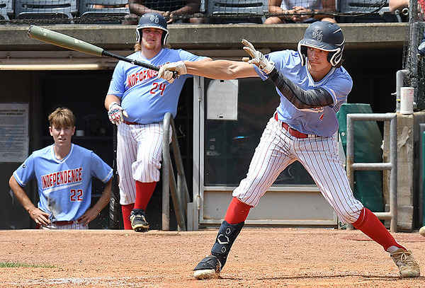Caleb Riddle, of Independence, reaches for a pitch against North Marion during the semi-final State Baseball Tournament held at Appalachian Power Park in Charleston Friday morning.<br /> (Rick Barbero/The Register-Herald)