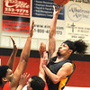 Mount View's Malaki Bishop puts up a jump shot over the defense of Greater Beckley's Jordan Mc Innis and Ezra Drumheller. Jon C. Hancock/for The Register-Herald