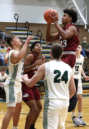Bluefields Tre Walker goes up for two against Wyoming East defenders Chandler Johnson and Tanner Whitten.<br /> Jim Cook/for the Register-Herald
