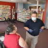 Gary Cunningham, pharmacist of Bypass Pharmacy on Eisenhower Drive in Beckley preparing to give a COVID-19 vaccinations to Tammy Rakes, of Sophia.<br /> (Rick Barbero/The Register-Herald)