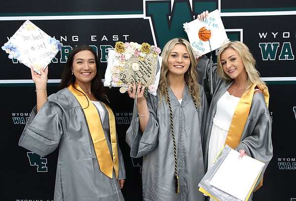 Tristian Lester, left, Cecily Adkins, and Skylar Davidson during Wyoming East graduation.<br /> Jim Cook for the Register-Herald