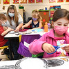 Kendall Walker, student in Lora Griffith's kindergarten class at Pineville Elementary School and other classmates are learning the letter P by making paper penguins.<br /> (Rick Barbero/The Register-Herald)