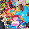 Fair worker Poochie Love hands Emily Prescott a stuffed animal prize at the State Fair of West Virginia Wednesday.  Jenny Harnish/The Register-Herald