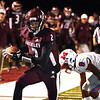 Keynan Cook, of Woodrow Wilson, left, caught a pass against Brodrick Washington, of Morgantown, in the second quarter for a touchdown during game held at Woodrow Wilson High School.<br /> (Rick Barbero/The Register-Herald)