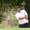 Davey Jude hits from the trap on the par 3, 17th hole during the final round of the Mountain State Golf Classic held on the Cobb course Monday.<br /> (Rick Barbero/The Register-Herald)